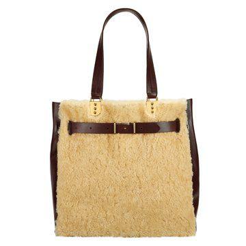 米黄色羊毛皮手提包
