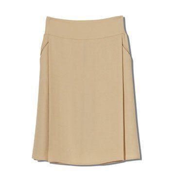 米黄色收腰半裙