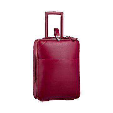 玫红色皮革旅行箱