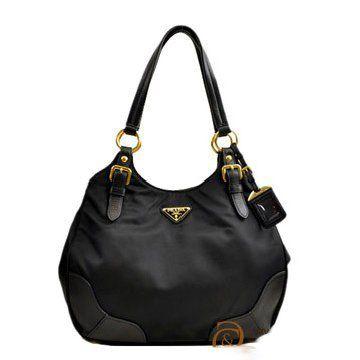 2011年春夏黑色尼龙配皮双手柄手提肩背两用三角金标经典吊牌女士手袋