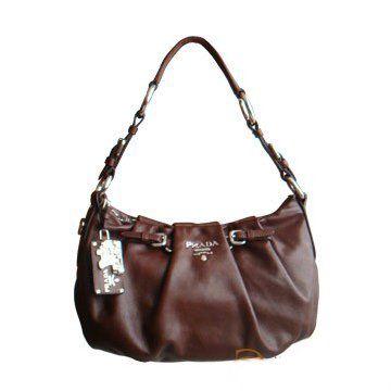 2011春夏新款棕色软牛皮搭配褶皱设计银色标装饰小号单肩背女士手袋