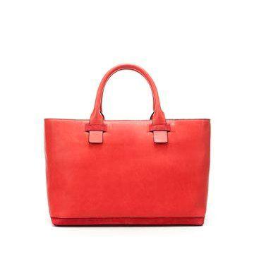 桃粉色皮革手提包